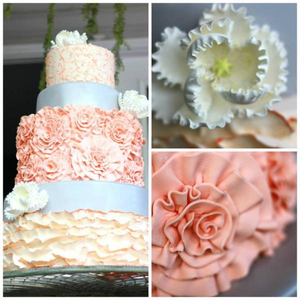 [Image: Three tiered cake in shades of coral and white with silver ribbon. Flowers and decorations are made out of buttercream and fondant. ]