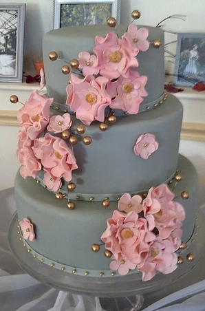 gray cake with pink flowers